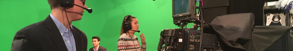 Male Student at News Desk in Background, Female Student Talking on Headset at Camera, Male Student At Camera, All Producing TV Show in Fairbanks Studio 44